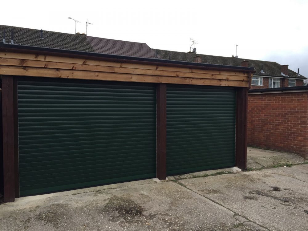 Fir Green coloured SeceuroGlide roller garage doors installed in Chinnor, Oxfordshire by Shutter Spec Security