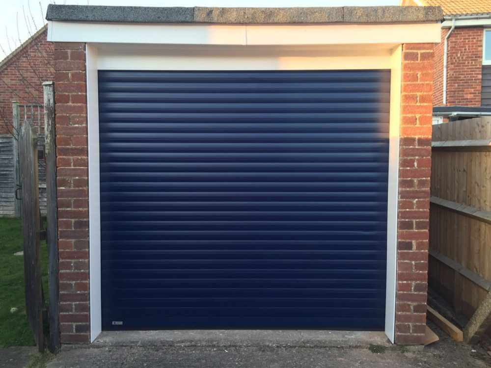 Navy Blue Seceuroglide Electric Roller Garage Door installed in Thame, Oxfordshire by Shutter Spec Security.