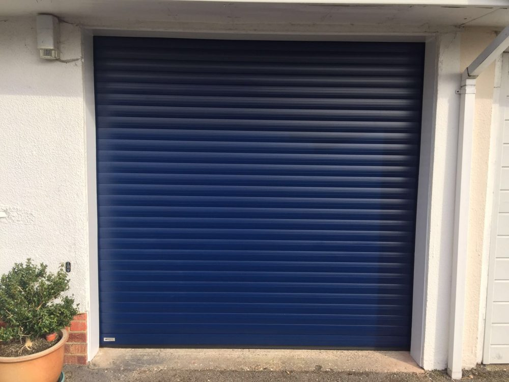 Navy Blue SeceuroGlide Roller Garage Door installed in Princes Risborough by Shutter Spec Security